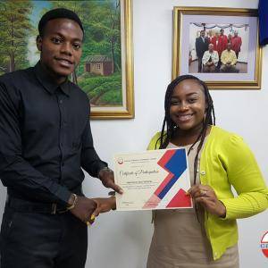 Customer service matters to us! Nemeica McFarlane, from our Publishing department, receives her certificate for training in proper customer service last year.