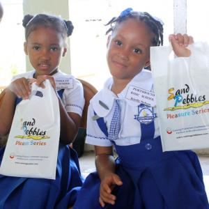 Carlong/Kiwanis Sand Pebbles Pleasure Series (SPPS) Literacy Competition 2019 - These girls from Portsmouth Basic School show off their Sand Pebbles gift bags.