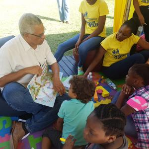 KBF Book Fair 2018 - B. B. Anders, author of children's science picture book Bet You Didn't Know!, shows his eager audience the board game that comes with the book at the Kingston Book Festival Book Fair in March 2018.